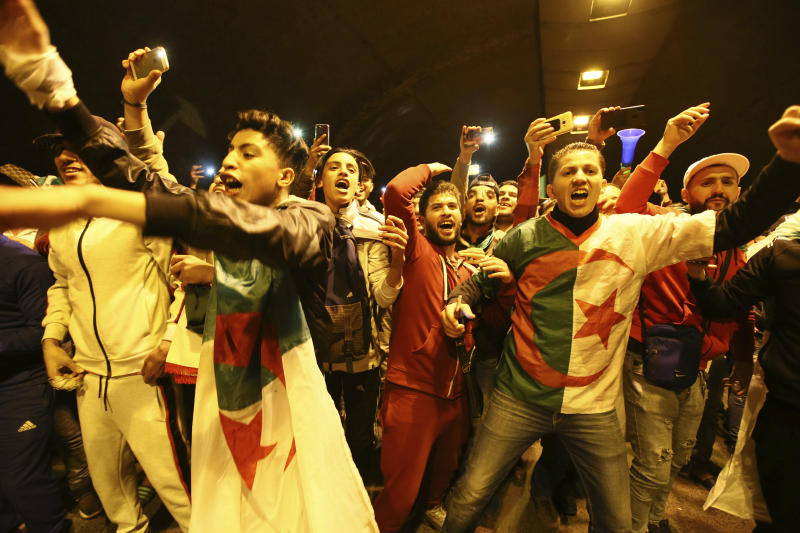 "People take the street to celebrate after ailing Algerian President Abdelaziz Bouteflika quit Tuesday April 2, 2019 in Algiers. Bouteflika quit in a statement read on national television after the country's Defense Ministry aggressively called for Bouteflika to ""immediately"" vacate the office he held for two decades. (AP Photo/Anis Belghoul)"
