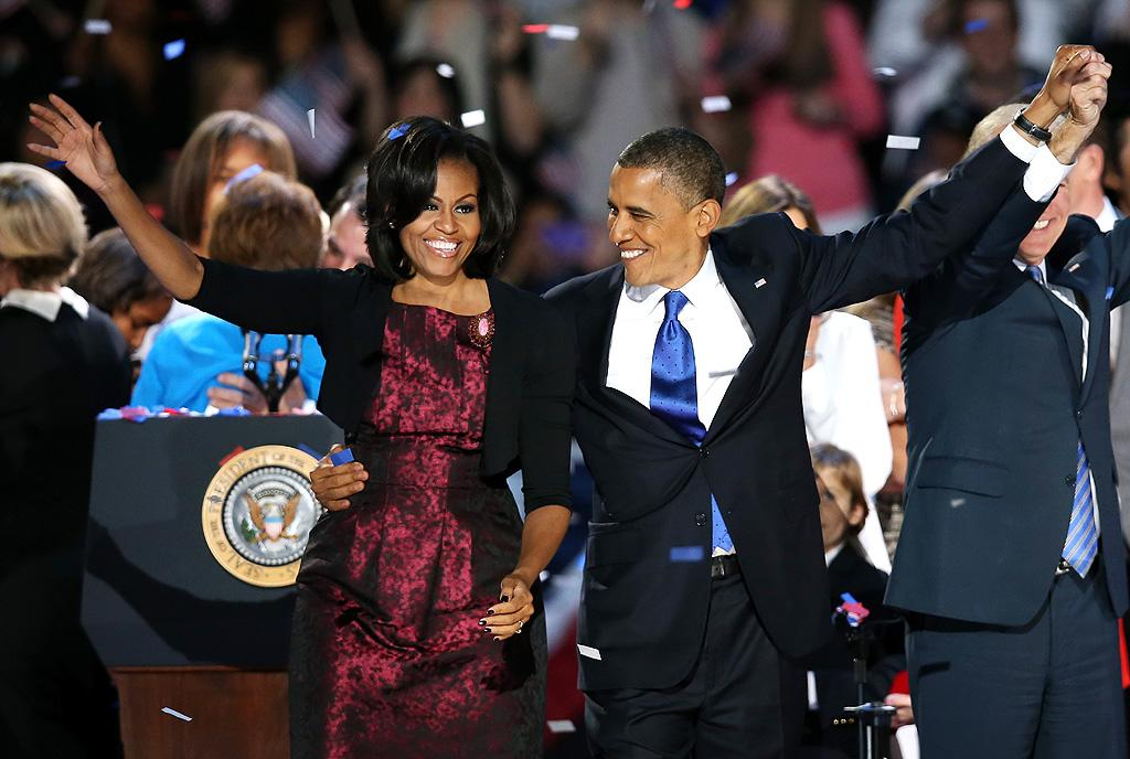 CHICAGO, IL - NOVEMBER 06:  U.S. President Barack Obama stands on stage with first lady Michelle Obama after his victory speech on election night at McCormick Place November 6, 2012 in Chicago, Illinois. Obama won reelection against Republican candidate, former Massachusetts Governor Mitt Romney.  (Photo by Scott Olson/Getty Images)