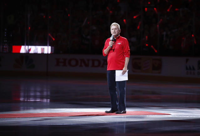 "Entertainer Pat Sajak, a <a class=""link rapid-noclick-resp"" href=""/nhl/teams/was"" data-ylk=""slk:Washington Capitals"">Washington Capitals</a> season ticket holder, introduces the players for the Capitals and the <a class=""link rapid-noclick-resp"" href=""/nhl/teams/vgk"" data-ylk=""slk:Vegas Golden Knights"">Vegas Golden Knights</a> before Game 3 of the NHL hockey Stanley Cup Final, Saturday, June 2, 2018, in Washington. (AP Photo/Alex Brandon)"