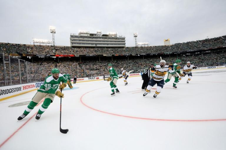 Roman Polak #45 of the Dallas Stars moves the puck against the Nashville Predators during the game, part of an annual outdoor NHL series