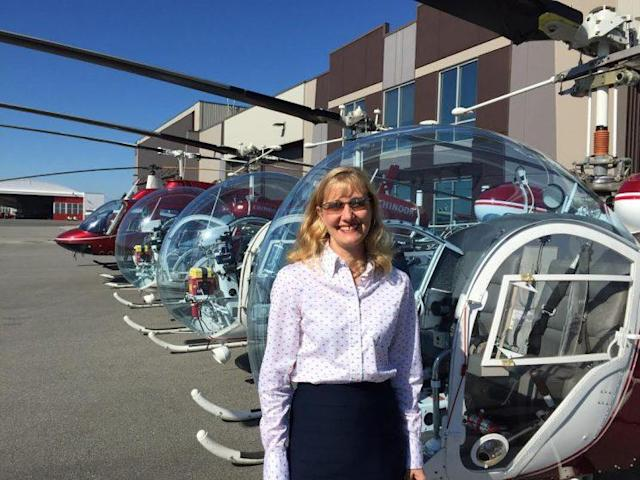 Cathy Press in front of her fleet at Chinook Helicopters. (Chinook Helicopters)