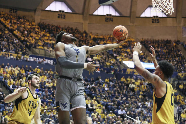 West Virginia forward Derek Culver (1) goes to make a shot as he is defended by Missouri forward Reed Nikko (14) and guard Torrence Watson (0) during the second half of an NCAA college basketball game Saturday, Jan. 25, 2020, in Morgantown, W.Va. (AP Photo/Kathleen Batten)