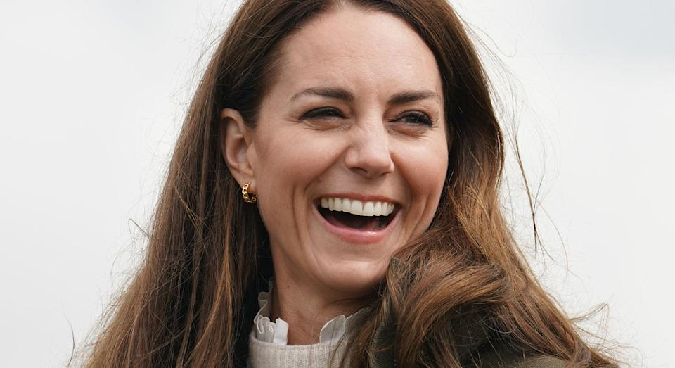 The Duchess of Cambridge has been styling a frilly blouse underneath jumpers, and this trend is here to stay.  (Getty images)