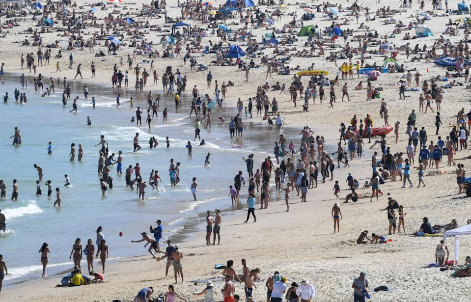 Crowds packed onto Bondi Beach with local law enforcement and council ambassadors on duty to ensure social distancing measures.