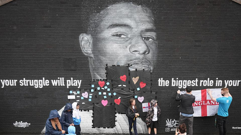 After a mural of Marcus Rashford was defaced following England's Euro 2020 some have chosen to try to repair the damage in the days after. (Photo by Christopher Furlong/Getty Images)