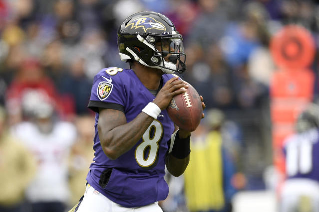 Baltimore Ravens quarterback Lamar Jackson looks to pass against the Houston Texans during the first half of an NFL football game, Sunday, Nov. 17, 2019, in Baltimore. (AP Photo/Nick Wass)