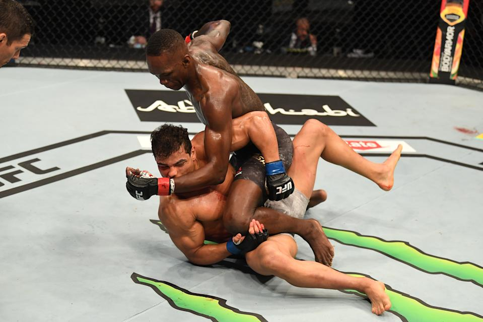 Israel Adesanya of Nigeria punches Paulo Costa of Brazil in their middleweight championship bout during UFC 253. (Photo by Josh Hedges/Zuffa LLC)