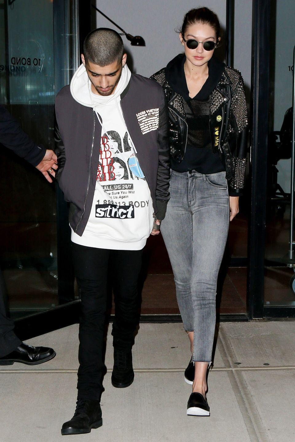 <p>Gigi Hadid left her NYC apartment with boyfriend Zayn Malik, dressed in a studded Burberry leather jacket, gray jeans and slip-on sneakers. </p>