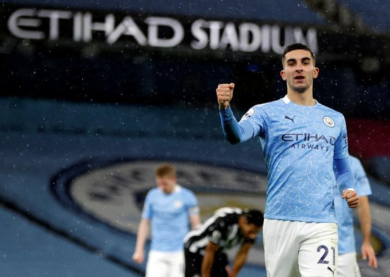 On the rise: Ferran Torres (right) scored Manchester City's second as they moved up to fifth in the Premier League
