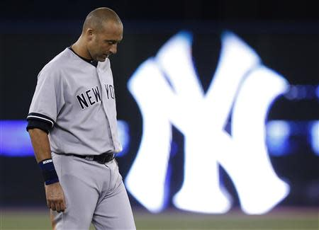 New York Yankees' Derek Jeter reacts after the end of the first inning against the Toronto Blue Jays during their MLB American League baseball game in Toronto in this file photo taken August 28, 2013. REUTERS/Mark Blinch/Files