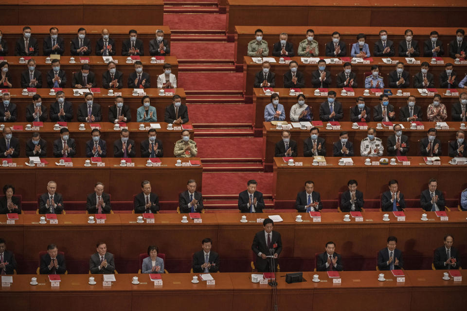 BEIJING, CHINA - MAY 28: Chinese president Xi Jinping, center, and premier Li Keqiang, center right, and other members of the government applaud during the closing session of the National People's Congress, which included a vote on a new draft security bill for Hong Kong,  at the Great Hall of the People on May 28, 2020 in Beijing, China. The Chinese government passed the draft by a vote of 2,878 votes to one during the session. The draft law, which has drawn international concern, is set to address issues such as secession, subversion, terrorism, and foreign interference, comes after a year of anti-government protests in the semi-autonomous region. China held its annual parliamentary gathering, known as 'The Two Sessions', at the Great Hall of the People from May 21-28th after being postponed at the height of the coronavirus outbreak in China earlier this year. (Photo by Kevin Frayer/Getty Images)