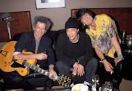 <p>Pitt hangs with Keith Richards and Ronnie Wood backstage at the Rolling Stones concert in Los Angeles. </p>