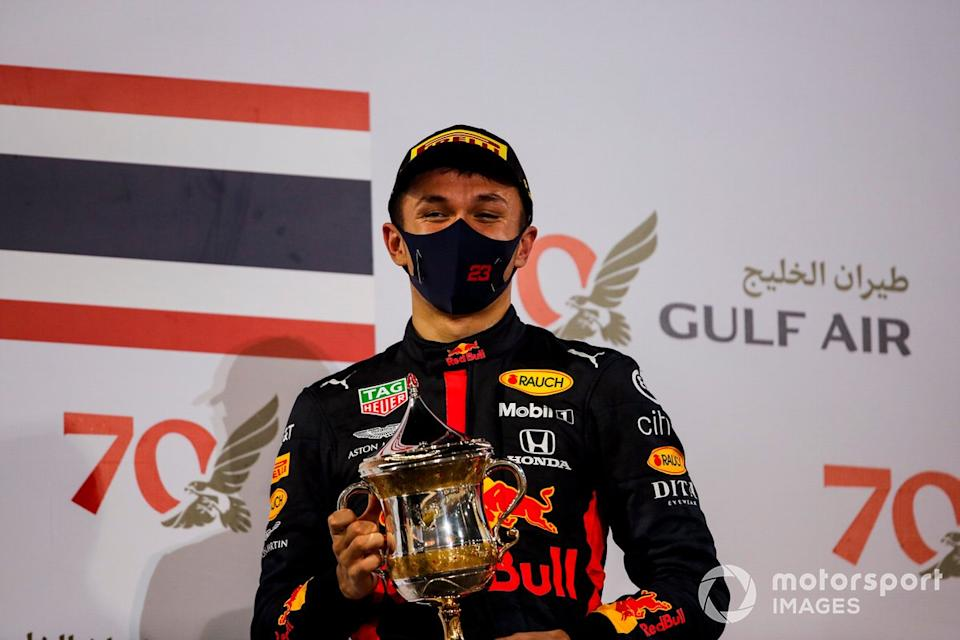 """Alex Albon, Red Bull Racing, 3rd position, on the podium<span class=""""copyright"""">Zak Mauger / Motorsport Images</span>"""