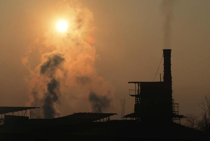 Fossil fuels satisfied nearly 70 percent of a jump in global energy demand last year which outstripped the expansion of renewables and helped drive record-high greenhouse gas emissions (AFP Photo/NARINDER NANU )