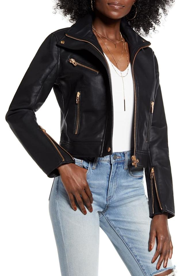 """<p>We like the gold hardware on this <a href=""""https://www.popsugar.com/buy/BLANKNYC-Essentials-Faux-Leather-Moto-Jacket-537942?p_name=BLANKNYC%20The%20Essentials%20Faux%20Leather%20Moto%20Jacket&retailer=shop.nordstrom.com&pid=537942&price=59&evar1=fab%3Aus&evar9=45205511&evar98=https%3A%2F%2Fwww.popsugar.com%2Ffashion%2Fphoto-gallery%2F45205511%2Fimage%2F47083099%2FBLANKNYC-Essentials-Faux-Leather-Moto-Jacket&list1=shopping%2Cfall%20fashion%2Ccoats%2Cfall%2Cjackets%2Cleather%20jackets%2Cwinter%20fashion&prop13=mobile&pdata=1"""" rel=""""nofollow"""" data-shoppable-link=""""1"""" target=""""_blank"""" class=""""ga-track"""" data-ga-category=""""Related"""" data-ga-label=""""https://shop.nordstrom.com/s/blanknyc-the-essentials-faux-leather-moto-jacket/5310171/full?origin=category-personalizedsort&amp;breadcrumb=Home%2FWomen%2FClothing%2FCoats%2C%20Jackets%20%26%20Blazers%2FLeather%20%26%20Faux%20Leather&amp;color=black"""" data-ga-action=""""In-Line Links"""">BLANKNYC The Essentials Faux Leather Moto Jacket</a> ($59, originally $98).</p>"""