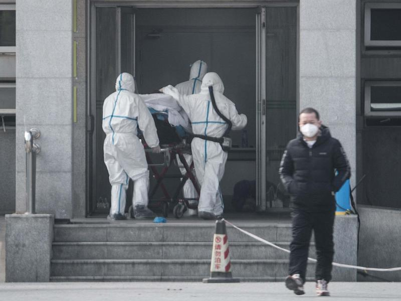 Medical staff carry a patient into Jinyintan hospital, where patients infected with a new strain of coronavirus identified as the cause of the Wuhan pneumonia outbreak are being treated, in Wuhan, China, 18 January 2020: EPA