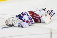 New York Rangers goaltender Igor Shesterkin (31) lies on the ice after suffering an injury during the third period of an NHL hockey game against the New Jersey Devils, Thursday, March 4, 2021, in Newark, N.J. (AP Photo/Kathy Willens)