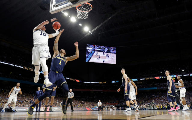 Villanova's Donte DiVincenzo (10) goes up for a shot over Michigan's Charles Matthews (1) during the second half in the championship game of the Final Four NCAA college basketball tournament, Monday, April 2, 2018, in San Antonio. (AP Photo/David J. Phillip)