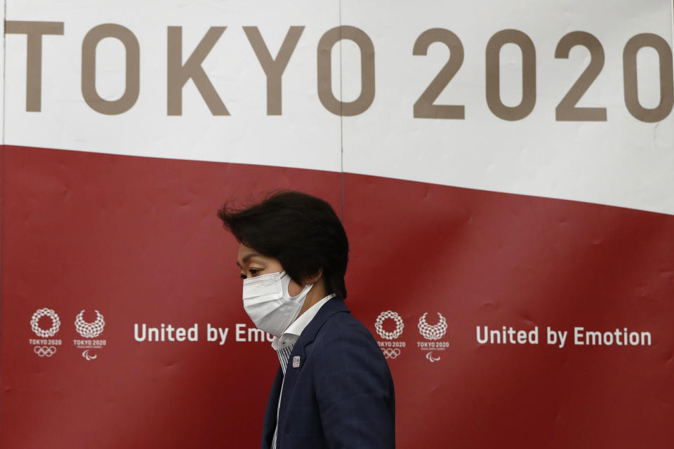 Tokyo 2020 Olympics Organizing Committee President Seiko Hashimoto arrives at a news conference after a meeting with local municipalities working group hosted by the government in Tokyo Wednesday, June 23, 2021, on the day to mark one month to go until the opening of the Olympic Games. (Issei Kato/Pool Photo via AP)