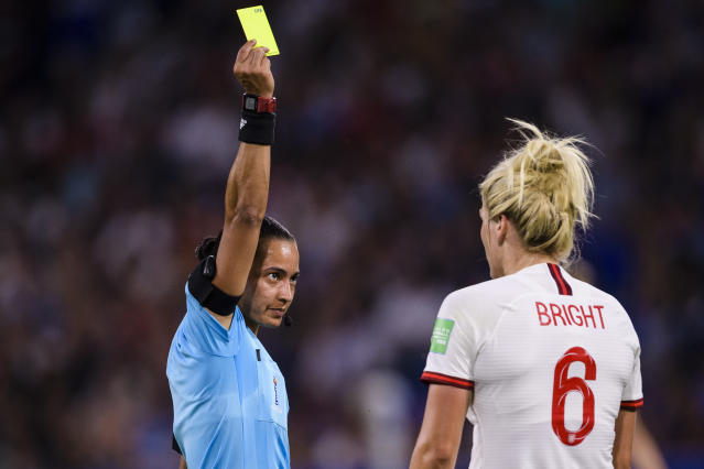FIFA Referee Edina Alves Batista of Brazil (L) shows a yellow card for Millie Bright of England (R) during the 2019 FIFA Women's World Cup France Semi Final match between England and USA at Stade de Lyon on July 2, 2019 in Lyon, France. (Photo by Marcio Machado/Getty Images)