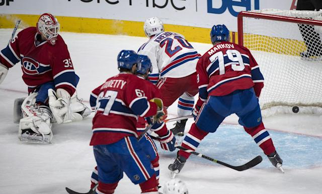 New York Rangers' Chris Kreider (20) scores past Montreal Canadiens goalie Dustin Tokarski during the second period of Game 5 of the NHL hockey Stanley Cup playoffs Eastern Conference finals, Tuesday, May 27, 2014, in Montreal. (AP Photo/The Canadian Press, Paul Chiasson)
