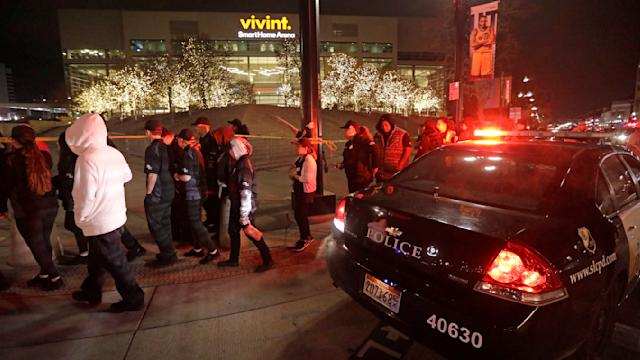 People leave Vivint Smart Home Arena after the Utah Jazz's home arena was evacuated because of a suspicious package following the team's NBA basketball game against the Golden State Warriors on Friday, Nov. 22, 2019, in Salt Lake City. Most fans had already left the building when players, coaches and reporters were instructed to leave the arena following Utah's 113-109 victory. (AP Photo/Rick Bowmer)
