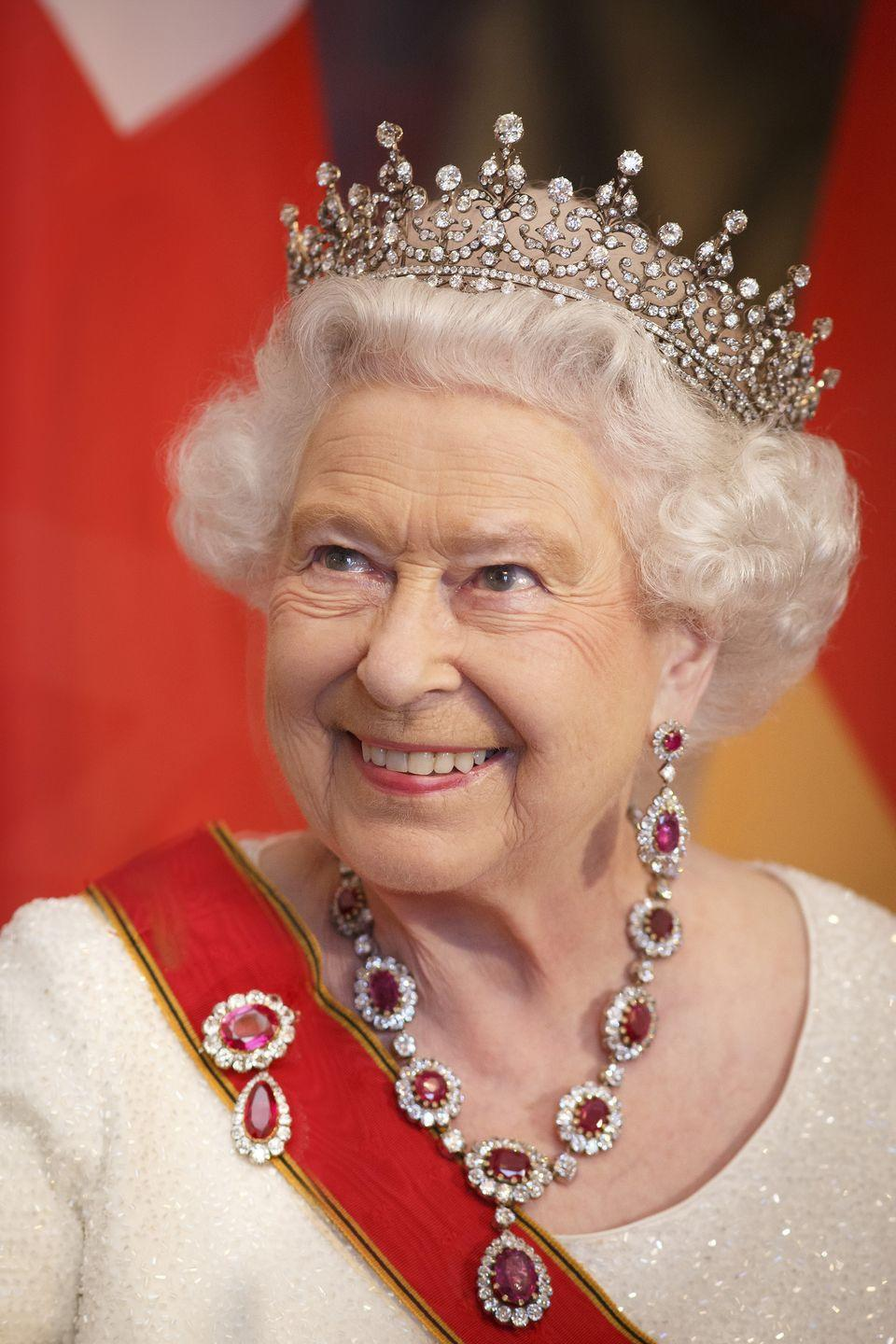 <p>The Girls of Great Britain and Ireland tiara is the headpiece most frequently worn by the Queen–it's even featured in her portrait on British currency. The tiara was a wedding gift from her grandmother, Queen Mary, and the first she owned herself. The tiara was originally a wedding gift for Mary when she married the Duke of York, who later became George V, in 1893. It was from the girls of Great Britain and Ireland, and commissioned by a committee lead by her friend, Lady Eve Greville.</p>