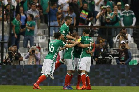 Football Soccer - Mexico v Costa Rica - World Cup 2018 Qualifiers - Azteca Stadium, Mexico City, Mexico - 24/3/17- Mexico's team celebrate a goal REUTERS/Edgard Garrido