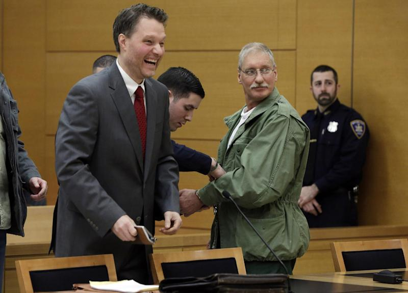David Ranta, right, with his attorney Pierre Sussman, has his handcuffs removed after Judge Miriam Cyrulnik freed him, in state Supreme Court in Brooklyn, New York, Thursday, March 21, 2013. Ranta, 58, who spent more than two decades behind bars was freed on Thursday after a reinvestigation of his case cast serious doubt on evidence used to convict him in the Feb. 8, 1990 shooting of Rabbi Chaskel Werzberger. (AP Photo/Richard Drew, Pool)
