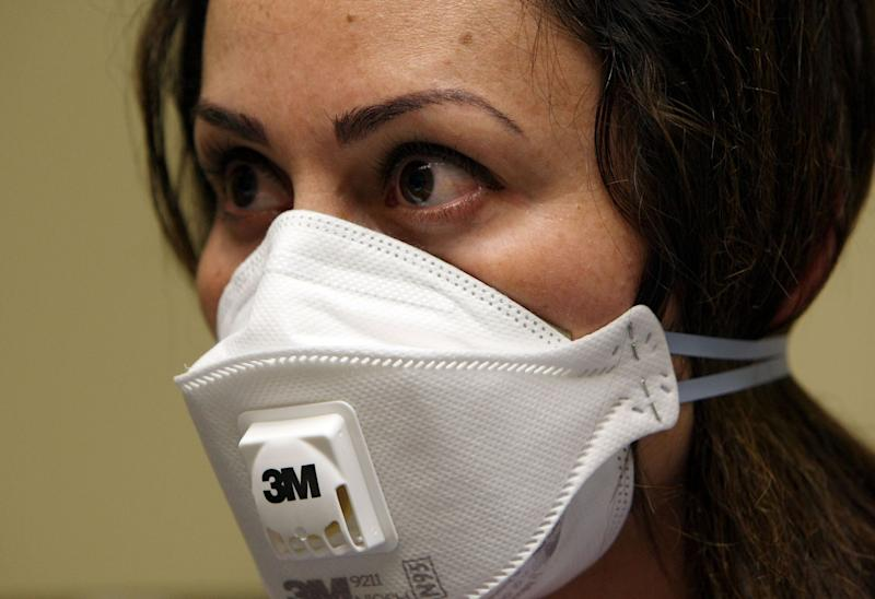 A nurse wears a N95 respiratory mask during a training session April 28, 2009 in Oakland, California during the height of the Swine Flu outbreak. (Photo: Justin Sullivan via Getty Images)