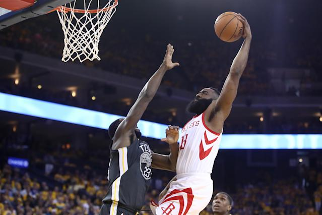 OAKLAND, CA - MAY 22: James Harden #13 of the Houston Rockets dunks the ball against Draymond Green #23 of the Golden State Warriors during Game Four of the Western Conference Finals of the 2018 NBA Playoffs at ORACLE Arena on May 22, 2018 in Oakland, California. (Photo by Ezra Shaw/Getty Images)