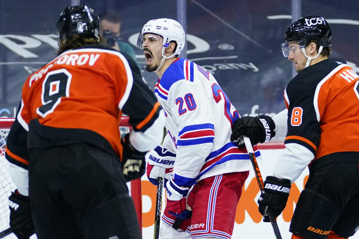 New York Rangers' Chris Kreider (20) reacts after scoring a goal as Philadelphia Flyers' Ivan Provorov (9) and Robert Hagg (8) look on during the second period of an NHL hockey game, Wednesday, Feb. 24, 2021, in Philadelphia. (AP Photo/Matt Slocum)