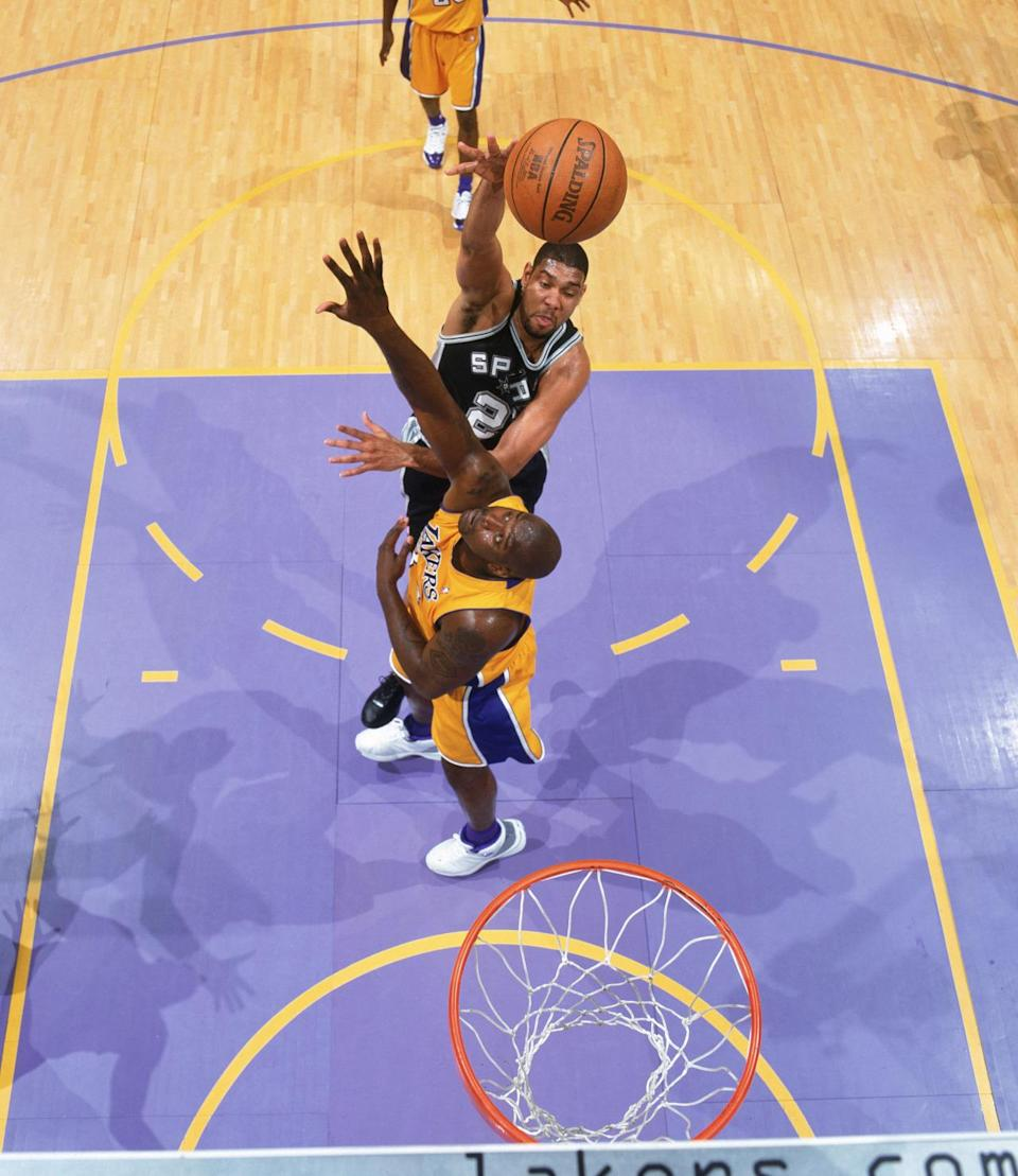 <p>2004: Tim Duncan #21 of the San Antonio Spurs shoots over Shaquille O'Neal #34 of the Los Angeles Lakers in Game Four of the Western Conference Semifinals during the 2004 NBA Playoffs at Staples Center on May 11, 2004 in Los Angeles, California.</p>