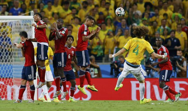 Brazil's David Luiz (4) shoots to score his freekick against Colombia during their 2014 World Cup quarter-finals at the Castelao arena in Fortaleza July 4, 2014. REUTERS/Marcelo Del Pozo (BRAZIL - Tags: SOCCER SPORT WORLD CUP TPX IMAGES OF THE DAY)