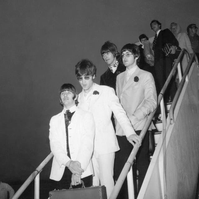 The Beatles pictured as they arrive back in London after going on tour (PA)