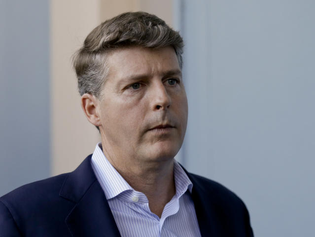 FILE - In this Wednesday, Nov. 15, 2017 file photo, Hal Steinbrenner, principal owner, managing general partner and co-chairman of the New York Yankees, talks with reporters at the annual MLB baseball general managers' meetings in Orlando, Fla. Hal Steinbrenner had heard the constant criticism in New York: Why haven't the Yankees tried to sign Bryce Harper and Manny Machado. While he won't rule out more moves before opening day, but he sounded as if a deal for a high-priced free agent is unlikely, Thursday, Deb. 7, 2019. (AP Photo/John Raoux, File)