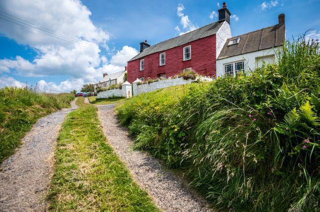 Colourful coastal cottages in Pembrokeshire (Photo: C T Aylward via Getty Images)