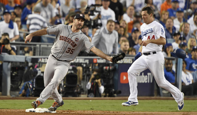 <p>Houston Astros starting pitcher Justin Verlander (35) tags out Los Angeles Dodgers starting pitcher Rich Hill (44) in the third inning in game two of the 2017 World Series at Dodger Stadium. Mandatory Credit: Robert Hanashiro-USA TODAY Sports </p>