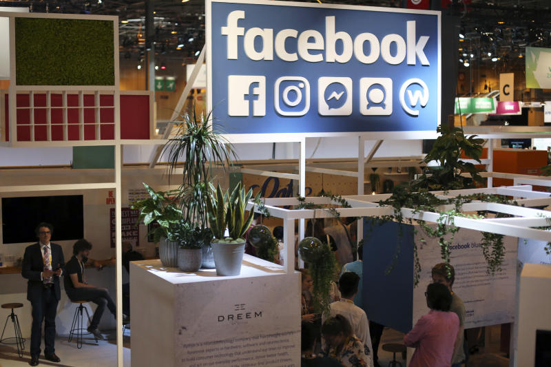 "FILE - In this June 16, 2017 file photo, the Facebook booth is seen at the Vivatech, a gadgets show in Paris, France. France has adopted a pioneering tax on internet giants like Google, Amazon and Facebook despite threats from the U.S. Just ahead of the vote Thursday, French economy minister Bruno Le Maire said allies needed to settle differences ""without using threats."" (AP Photo/Thibault Camus, File)"