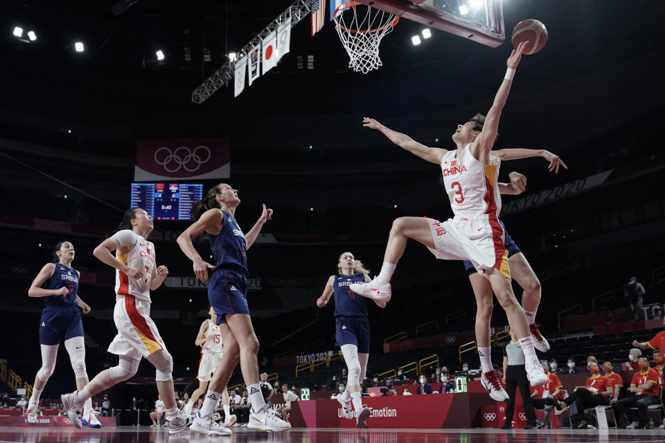 China's Liwei Yang (3) is fouled as she drives to the basket against Serbia during a women's basketball quarterfinal game at the 2020 Summer Olympics, Wednesday, Aug. 4, 2021, in Saitama, Japan. (AP Photo/Eric Gay)