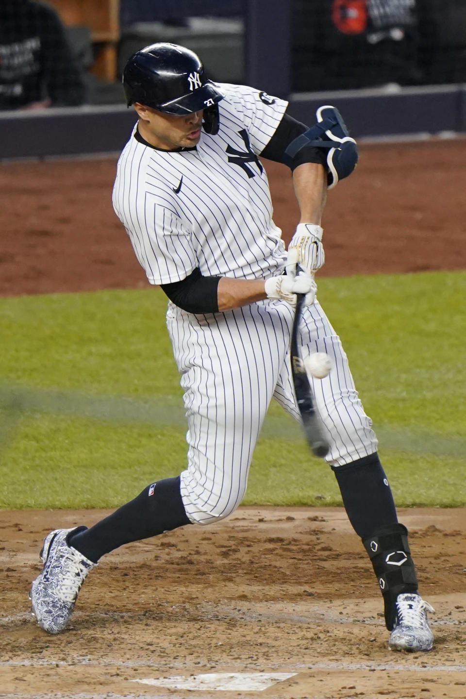 New York Yankees designated hitter Giancarlo Stanton grounds into a double play with two runners on base in the third inning of the team's baseball game against the Baltimore Orioles, Wednesday, April 7, 2021, at Yankee Stadium in New York. (AP Photo/Kathy Willens)
