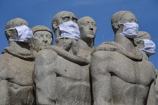 Statues of the Monumento das Bandeiras wear face masks in Sao Paulo, Brazil, on May 12, 2020, during the novel coronavirus COVID-19 pandemic. - Brazil has emerged as the epicenter of the pandemic in Latin America, with 11,519 deaths so far. (Photo by NELSON ALMEIDA / AFP) (Photo by NELSON ALMEIDA/AFP via Getty Images)
