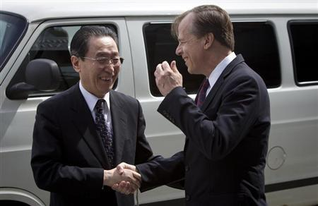 U.S. Special Representative for North Korea Policy Davies shakes hands with China's special representative for Korean Peninsula Affairs Wu in New York
