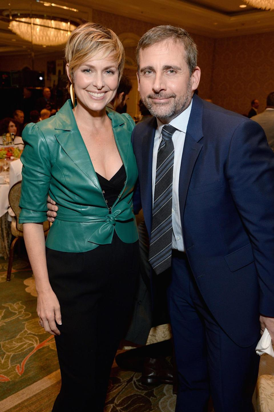 Melora Hardin wears a teal, tight, and leather top while Steve Carrell goes for understated handsomeness.