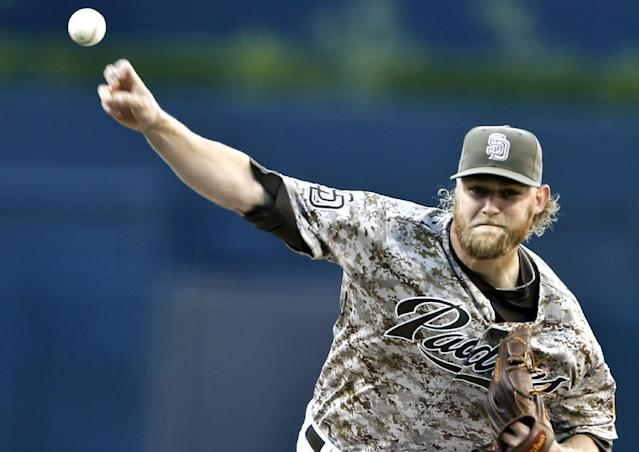 San Diego Padres starting pitcher Andrew Cashner throws against the Los Angeles Dodgers in the first inning of a opening season baseball game, Sunday, March 30, 2014, in San Diego. (AP Photo/Lenny Ignelzi)