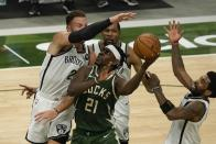 Milwaukee Bucks' Jrue Holiday shoots in traffic during the second half of an NBA basketball game against the Brooklyn Nets Sunday, May 2, 2021, in Milwaukee. (AP Photo/Morry Gash)