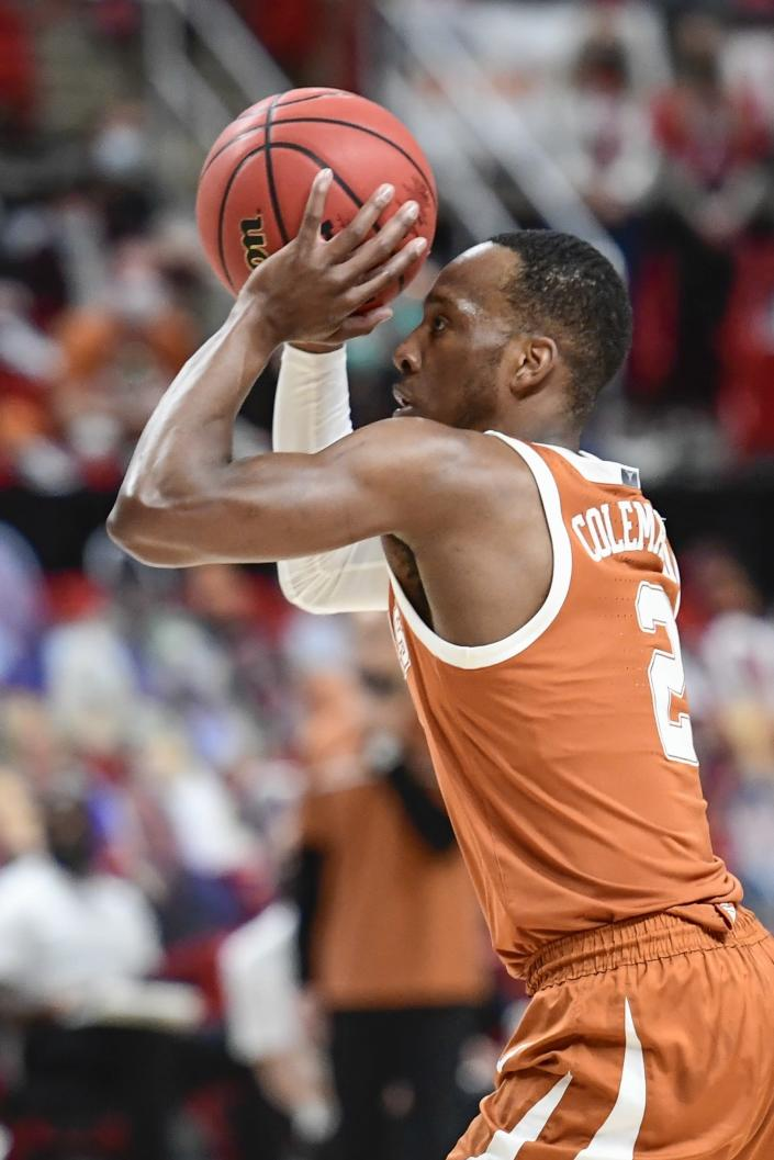 Texas' Matt Coleman III (2) attempts to shoot for three point during the first half of an NCAA college basketball game against Texas Tech in Lubbock, Texas, Saturday, Feb. 27, 2021. (AP Photo/Justin Rex)
