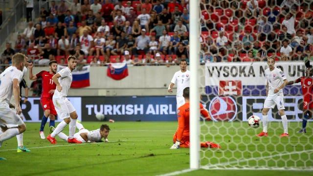 Adam Lallana, second left, scores the only goal in Sam Allardyce's solitary game in charge of England, against Slovakia in Trnava