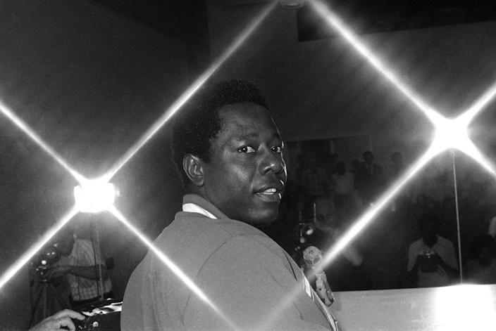 Atlanta Braves' Hank Aaron looks on during a news conference April 1, 1974, in New Orleans.