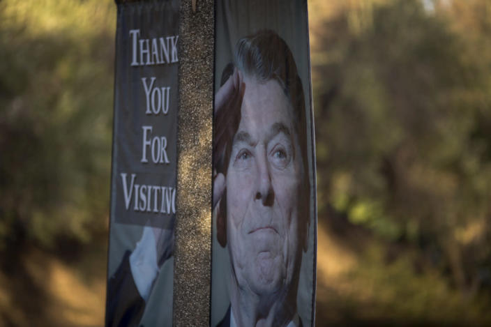 <p>A banner bearing the image of President Reagan is suspended from a lamp pole near the Ronald Reagan Presidential Library as arrangements are made for memorial services for Nancy Reagan. <i>(Photo: David McNew/Getty Images)</i></p>